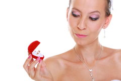 Girl looks at box with engagement or wedding ring, isolated Royalty Free Stock Photography