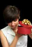 Girl looks in box with a gift Stock Photo