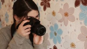 The girl looks at the camera. Viewfinder and takes photos stock video