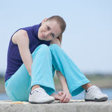 Girl looks at the camera smiling Royalty Free Stock Photography