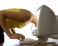 Girl looks at  computer monitor Royalty Free Stock Photography