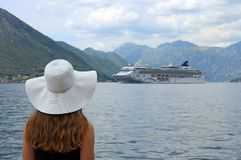 The girl looks at the cruise ship Royalty Free Stock Image