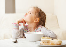 Girl looks with disgust for food Stock Photos