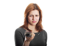 Girl looks in disgust at the remaining hair on the comb Royalty Free Stock Images
