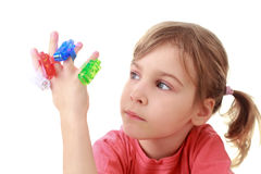 Girl looks at flashlights which are on fingers Royalty Free Stock Photo