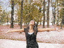 The girl looks forward to the sudden snow Royalty Free Stock Photography