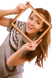 Girl looks through framework Stock Image