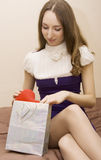 girl looks a gift Royalty Free Stock Images