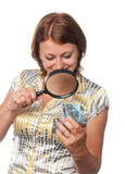 Girl looks at a gift through a magnifier Stock Photos