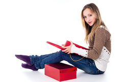 Girl looks at gifts, isolated red boxes Royalty Free Stock Photos