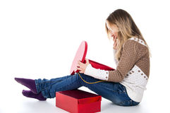 Girl looks at gifts, red boxes Royalty Free Stock Images