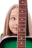 Beautiful girl with guitar  on white background. The girl looks at a guitar,  close-up stock photo