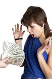 Girl looks at a hand with dollars Stock Image