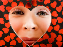 The girl looks through heart Royalty Free Stock Images