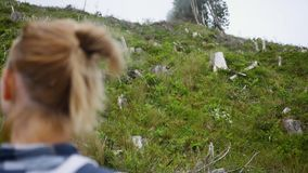 Young girl looks at traces of deforestation and human impact on the environment