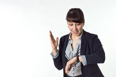 Girl looks at his watch. Isolated image Stock Photos