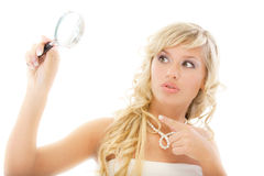 Girl looks in magnifier and is Stock Images