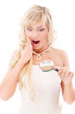 Girl looks in magnifier and is surprised Stock Photo
