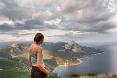 Girl looks at majestic landscape Royalty Free Stock Photography