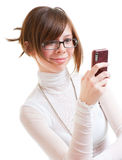 Girl looks into mobile phone Royalty Free Stock Image