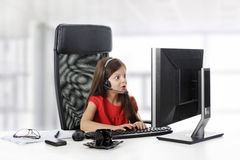 Girl looks in the  monitor. Stock Photography