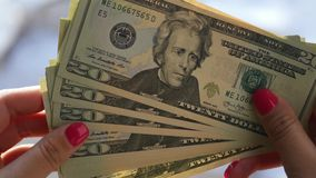 Girl looks at the new twenty-dollar bills in his hands, 4k, 3840x2160, stock video footage