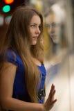 Girl looks at night shopwindow Stock Photo