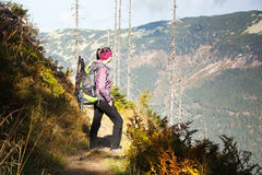 Girl with looks out over the mountains, Czech mountains Krkonose Royalty Free Stock Photos