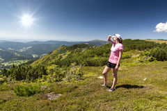 Girl looks out over the mountains, Hike Royalty Free Stock Images
