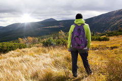 Girl looks out over the mountains, Hike Royalty Free Stock Image