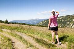 Girl looks out over the mountains, Hike Royalty Free Stock Photo