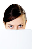 Girl looks out because of paper Royalty Free Stock Photography