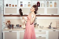 The girl looks into the pan. Royalty Free Stock Image