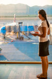 Girl looks   on the plane Royalty Free Stock Photography
