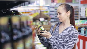 Girl looks products at grocery store