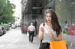 Girl looks at the purchase the check Royalty Free Stock Photo