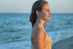 Girl looks at the sea sunset Stock Image