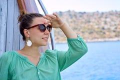 The girl looks at the sea. Turkey Royalty Free Stock Photo