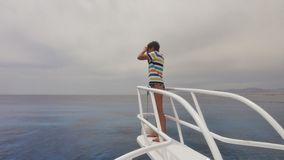 The girl looks into the sea on a yacht Royalty Free Stock Image