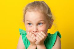 Girl looks shocked at camera. on white background. stock photography