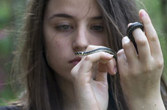 Girl looks at a snake Royalty Free Stock Photography