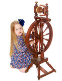 The girl looks at the spinning wheel Stock Photo
