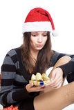 The girl looks with surprise on Christmas box isolated on white background Royalty Free Stock Images