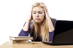 Girl looks tired a laptop on the books Stock Images
