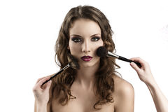 Girl looks in to the lens, getting made-up Stock Image