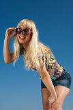 Girl looks on top of sunglasses Stock Images