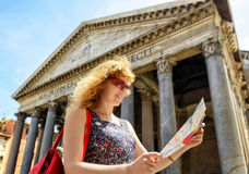 The girl looks at a tourist map in front of the Pantheon, Rome Stock Image