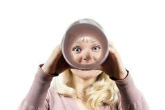 Girl looks in the tube Royalty Free Stock Images