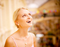 Girl looks upwards and laughs Stock Image