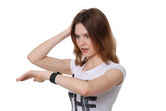 The girl looks at the watch Royalty Free Stock Photos